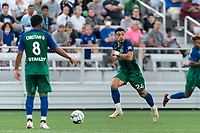 HARTFORD, CT - AUGUST 17: Darwin Lom #24 of Hartford Athletic looks to pass during a game between Charleston Battery and Hartford Athletic at Dillon Stadium on August 17, 2021 in Hartford, Connecticut.