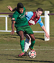 Stirling's Khan Williams Mitchell and Whitehill's Wayne McIntosh challenge for the ball.