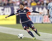New England Revolution midfielder Lee Nguyen (24) brings the ball forward.  In the first game of two-game aggregate total goals Major League Soccer (MLS) Eastern Conference Semifinal series, New England Revolution (dark blue) vs Sporting Kansas City (light blue), 2-1, at Gillette Stadium on November 2, 2013.