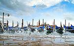 """Venice, Italy. Gondolas at moorings. """"fero da prorà"""" or """"dol fin"""""""