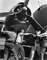 Checking finished PV-1 at the Vega aircraft plant, Burbank, Calif.  Workmen spin propeller.  August 1943.  Lt. Comdr. Charles Fenno Jacobs. (Navy)<br /> Exact Date Shot Unknown<br /> NARA FILE #:  080-G-412633<br /> WAR & CONFLICT BOOK #:  808