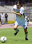 UNAM Pumas forward Bruno Marioni drives the ball during his soccer match with UAG Tecos,  March 19, 2006 at the University Stadium in Mexico City. UAG Tecos won 1-0 to UNAM Pumas. Photo by © Javier Rodriguez