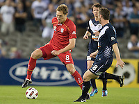 MELBOURNE, AUSTRALIA - OCTOBER 30: Adam Hughes of United controls the ball during the round 12 A-League match between the Melbourne Victory and Adelaide United at Etihad Stadium on October 30, 2010 in Melbourne, Australia.  (Photo by Sydney Low / Asterisk Images)