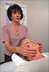 therapist aligning patient's chakra during Reiki massage