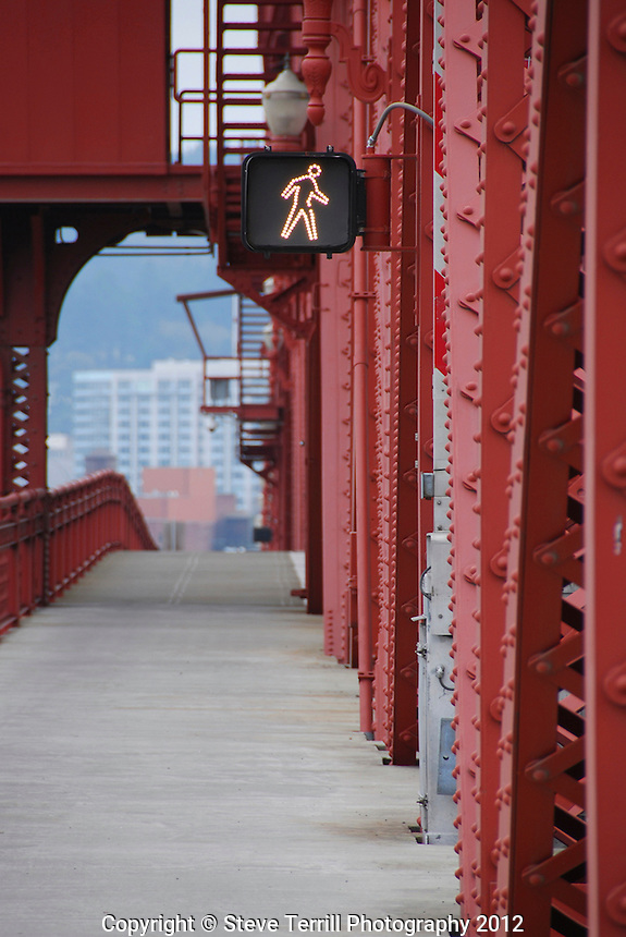 Walk sign on Broadway Bridge in Portland Oregon