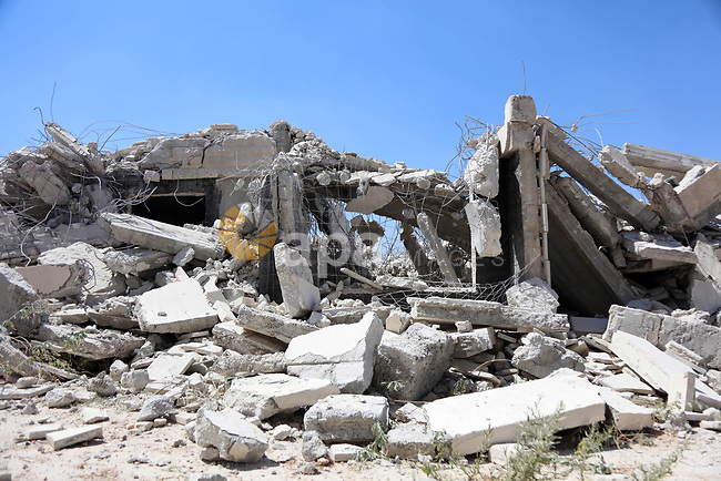 A picture shows the demolition of a Palestinian building which was under construction, in the the Palestinian village of Sur Baher in East Jerusalem, July 22, 2019. Israel demolished a number of Palestinian homes it considers illegally constructed near its separation barrier south of Jerusalem on July 22, in a move that drew international condemnation. Palestinian leaders slammed the demolitions in the Sur Baher area which straddles the occupied West Bank and Jerusalem. Photo by Abedalrahman Hassan