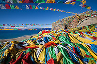 The five colors of traditional Tibetan prayer flags represent the elements of fire, water, earth, wind and sky