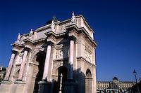 The Arc de Triomphe du Carrousel with the Louvre Museum in the background, Paris, France.