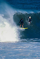 Wayne Lynch (AUS) and Tom Curren (USA) surfing Mundaka river-mouth during an epic swell in November 1989. Mundaka, Basque Country, Spain. Photo: joliphotos.com