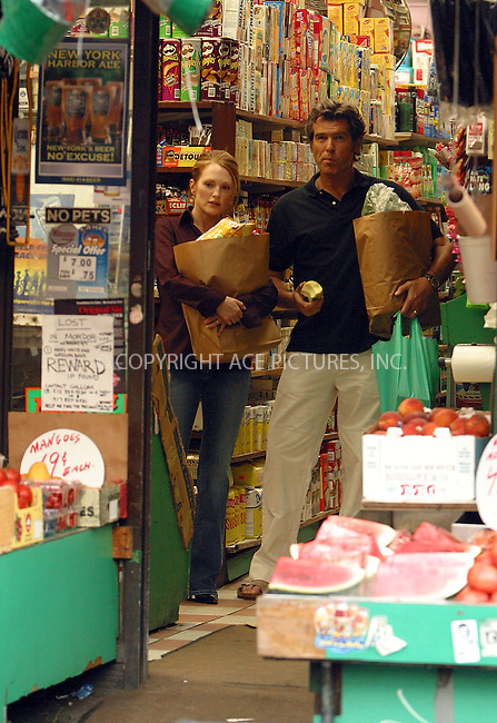 """Pierce Brosnan and Julianne Moore filming """"Laws of Attraction"""" in New York. August 19, 2003. Please byline: NY Photo Press.   ..*PAY-PER-USE*      ....NY Photo Press:  ..phone (646) 267-6913;   ..e-mail: info@nyphotopress.com"""