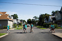 """Members make their way through the Hawthorne neighborhood during """"Circle the City with Service,"""" the Kiwanis Circle K International's 2015 Large Scale Service Project, on Wednesday, June 24, 2015, in Indianapolis. (Photo by James Brosher)"""