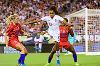 PHILADELPHIA, PA - AUGUST 29: Jéssica Silva #10 of Portugal is defended by Allie Long #20 and Crystal Dunn #19 of the United States during a game between Portugal and USWNT at Lincoln Financial Field on August 29, 2019 in Philadelphia, PA.