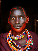 Maasai tribesman with a painted face on his wedding day. Tipilit village near Amboseli National Park, Kenya