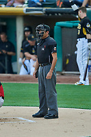 Umpire Nestor Ceja handles the calls behind the plate during the game between the Salt Lake Bees and the Nashville Sounds at Smith's Ballpark on July 27, 2018 in Salt Lake City, Utah. The Bees defeated the Sounds 8-6. (Stephen Smith/Four Seam Images)
