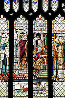 Detail of a stained glass window depicting the crowning of a king, Bath Abbey.