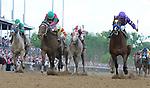 Plum Pretty, ridden by Martin Garcia, outruns St. John's Bay, ridden by Rosie Napravnik to win the Kentucky Oaks at Churchill Downs in Louisville, Kentucky on May 6, 2011