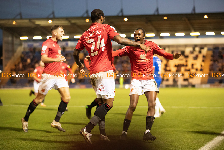 The celebrations begin after Yann Songo'o of Morecambe had restored their lead with the second goal during Colchester United vs Morecambe, Sky Bet EFL League 2 Football at the JobServe Community Stadium on 19th December 2020