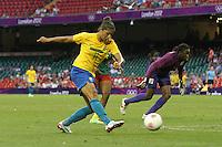 CRISTIANE of Brazil scores the fourth goal for her team - Brazil Women vs Cameroon Women - Womens Olympic Football Tournament London 2012 Group E at the Millenium Stadium, Cardiff, Wales - 25/07/12 - MANDATORY CREDIT: Gavin Ellis/SHEKICKS/TGSPHOTO - Self billing applies where appropriate - 0845 094 6026 - contact@tgsphoto.co.uk - NO UNPAID USE.