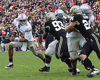 Ohio State quarterback Terrelle Pryor (2) tries to outrun the Purdue defense. The Purdue Boilermakers defeated the Ohio State Buckeyes 26-18 at Ross-Ade Stadium, West Lafayette, Indiana on October 17, 2009..