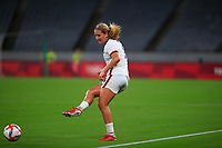 TOKYO, JAPAN - JULY 20: Lindsey Horan #9 of the United States passes off the ball during a game between Sweden and USWNT at Tokyo Stadium on July 20, 2021 in Tokyo, Japan.