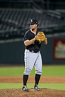 AZL White Sox relief pitcher Ryan Riga (84) prepares to deliver a pitch to the plate against the AZL Cubs on August 13, 2017 at Sloan Park in Mesa, Arizona. AZL White Sox defeated the AZL Cubs 7-4. (Zachary Lucy/Four Seam Images)