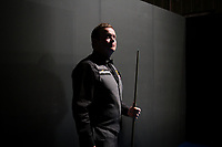 CHINA. Beijing. English snooker player Shaun Murphy backstage just before going to play at the China Snooker Open. Snooker is a cue sport played on a large table measuring 3.6 metres x 1.8 metres. Originating in India in the late 19th Century where it was invented by British Army officers, the game has been a mainstay in British sport over the past few decades. Recently however, popularity of the sport has declined as the sport struggles to compete with other popular sports. The sport is however flourishing in countries such as China, where it is now the second most popular sport, behind Basketball. In a country where the  players are treated like movie-stars, China may be the great hope for the sports recovery. 2009