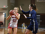 SIOUX FALLS, SD - MARCH 6: Maddie Krull #42 of the South Dakota Coyotes shoots past Regan Schumacher #20 of the Oral Roberts Golden Eagles during the Summit League Basketball Tournament at the Sanford Pentagon in Sioux Falls, SD. (Photo by Richard Carlson/Inertia)