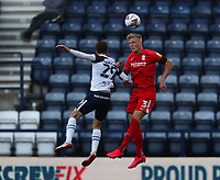 31st October 2020; Deepdale Stadium, Preston, Lancashire, England; English Football League Championship Football, Preston North End versus Birmingham City; Kristian Pedersen of Birmingham City wins a header challenged by Tom Barkhuizen of Preston North End
