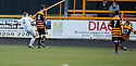 Referee Craig Charleston gives a penalty after Alloa's Jason Marr pulls down Dumbarton's Andy Graham.