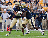 Pitt running back Zack Brown (4) takes a hand off from quarterback Tino Sunseri (12). The Pittsburgh Panthers beat the Buffalo Bulls 35-16 at Heinz field in Pittsburgh, Pennsylvania on September 3, 2011