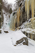 Pitcher Falls in Albany, New Hampshire during the winter months. This waterfall is located next to Champney Falls along the Champney Falls Trail. And during the winter months it is popular with ice climbers.