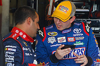 17 June, 2011: Kyle Busch and Juan Pablo Montoya discuss the finer points of twitter before practicing for the 43rd Annual Heluva Good! Sour Cream Dips 400 at Michigan International Speedway in Brooklyn, Michigan. (Photo by Jeff Speer :: SpeerPhoto.com)