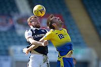 3rd April 2021; Dens Park, Dundee, Scotland; Scottish FA Cup Football, Dundee FC versus St Johnstone; Paul McMullan of Dundee competes in the air with Callum Booth of St Johnstone