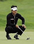 JEJU, SOUTH KOREA - APRIL 23:  Hong Soon-sang of Korea lines up a putt on the 17th green during the fog-delayed Round One of the Ballantine's Championship at Pinx Golf Club on April 23, 2010 in Jeju island, South Korea.  Photo by Victor Fraile / The Power of Sport Images