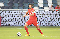 KANSAS CITY, KS - JULY 15: Steven Vitoria #5 of Canada with the ball during a game between Canada and Haiti at Children's Mercy Park on July 15, 2021 in Kansas City, Kansas.