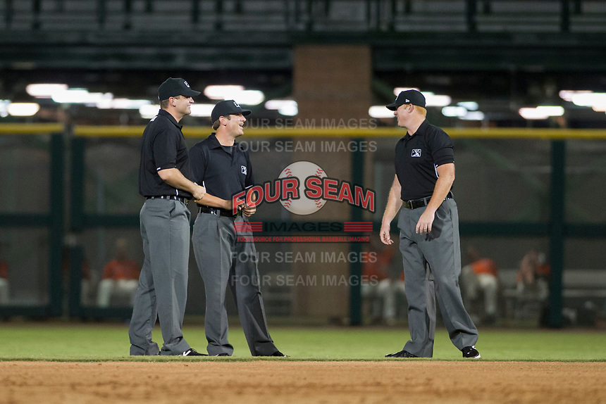 Minor League Umpires Pete Talkington, Jeff Hamann, and Ray Patchen enjoy a laugh between innings of a game between the AZL Cubs and AZL Giants on September 5, 2017 at Scottsdale Stadium in Scottsdale, Arizona. AZL Cubs defeated the AZL Giants 10-4 to take a 1-0 lead in the Arizona League Championship Series. (Zachary Lucy/Four Seam Images)
