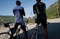 Day cyclists stop to cheer on triathlete Gina Crawford as she passes through the village of Greolieres during Ironman France 2012, Nice, France, 24 June 2012