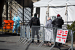 People wait in line in front of a tent to get screened for Covid-19 in front of the Brooklyn Hospital Center in the Brooklyn borough of New York, the United States, Thursday, April 2, 2020.   Worldwide coronavirus cases have surpassed 1,000,000.  Photograph by Michael Nagle