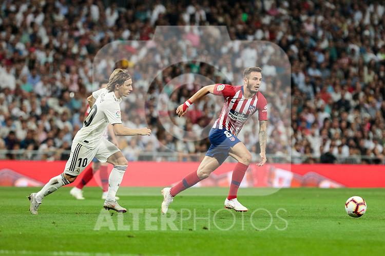 Real Madrid's Luka Modric and Atletico de Madrid's Saul Niguez during La Liga match between Real Madrid and Atletico de Madrid at Santiago Bernabeu Stadium in Madrid, Spain. September 29, 2018. (ALTERPHOTOS/A. Perez Meca)