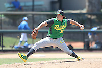 Jordan Spencer #23 of the Oregon Ducks pitches against the UCLA Bruins at Jackie Robinson Stadium on May 18, 2014 in Los Angeles, California. Oregon defeated UCLA, 5-4. (Larry Goren/Four Seam Images)