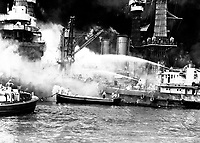 Pearl Harbor, taken by surprise, during the Japanese aerial attack.  USS WEST VIRGINIA aflame.  December 7, 1941.  (Navy)<br /> NARA FILE #:  080-G-19947<br /> WAR & CONFLICT BOOK #:  1137