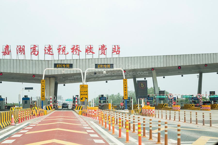 Suzhou, Jiangsu, China.  Highway Toll Booth between Suzhou and Shanghai. Electronic Toll Collection Lane.