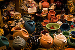 Fiesta Ware and other items displayed on store window.