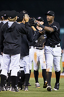 Micker Adolfo (24) of the Kannapolis Intimidators celebrates with his teammates following their win over the Augusta GreenJackets at Kannapolis Intimidators Stadium on May 3, 2017 in Kannapolis, North Carolina.  The Intimidators defeated the GreenJackets 7-4.  (Brian Westerholt/Four Seam Images)