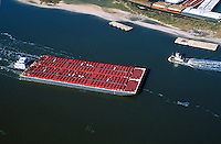 Aerial view of barges and a tugboat in the Houston ship channel. Houston, Texas.