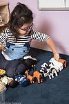 Education Preschool toddler-2s program girl linking bu toy animals by type