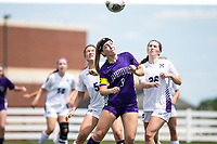 Madeline Wilburn (9) of Fayetteville heads ball against St. Mary's Academy  at Wildcat Stadium, Springdale, Arkansas, Friday, May 14, 2021 / Special to NWA Democrat-Gazette/ David Beach