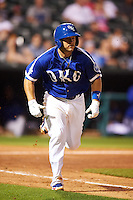 Oklahoma City Dodgers catcher Brian Ward (10) runs to first during a game against the Fresno Grizzles on June 1, 2015 at Chickasaw Bricktown Ballpark in Oklahoma City, Oklahoma.  Fresno defeated Oklahoma City 14-1.  (Mike Janes/Four Seam Images)