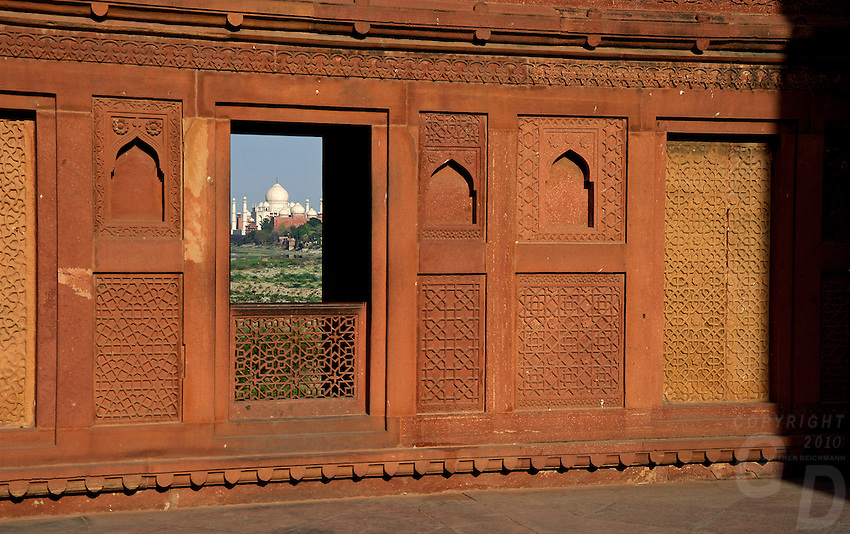 Agra Fort is a UNESCO World Heritage site located in Agra, India. The fort is also known as Lal Qila, Fort Rouge and Red Fort of Agra. It is about 2.5 km northwest of its much more famous sister monument, the Taj Mahal. The fort can be more accurately described as a walled palatial city...It is the most important fort in India. The great Mughals Babur, Humayun, Akbar, Jehangir, Shah Jahan and Aurangzeb lived here, and the country was governed from here. It contained the largest state treasury and mint. It was visited by foreign ambassadors, travellers and the highest dignitaries who participated in the making of history in India.. The Red Fort in Agra