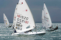 Laser Radial sail boats race one another.